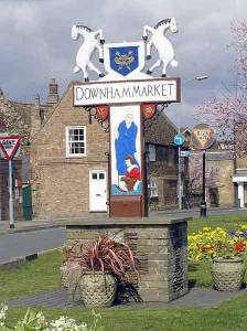 Town Sign - Nelson learning to sail in the streams of Downham Market!