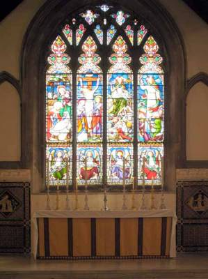 High Altar.   Previously a Reredos panel stood behind this - between the tiled panels, to the height of the glazing's lower bar.