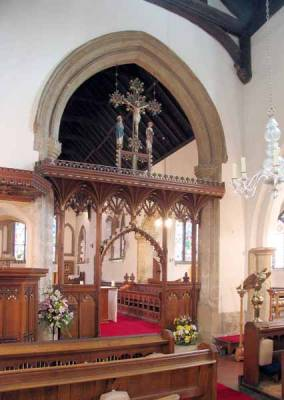 Nave and choir pews 1872-3, eagle Lectern 1886, Rood Screen 1912, glass chandelier c.1730.