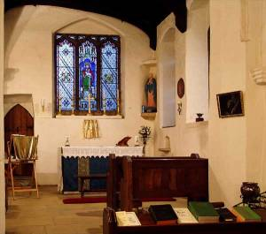 Lady Chapel - before the 2004 reordering.  (Note the very large altar for the space available and room for only 7 seated.)