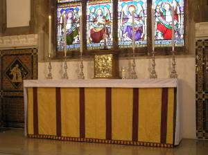 The Altar, with the new Tabernacle secured, surmounted by the Crucifix and flanked by six candles